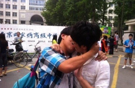 A gay student couple kissing after the Gaokao exam