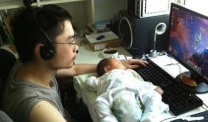 Father played computuer games and put his baby in front of the computer