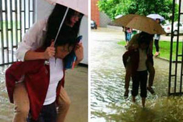 A cleaning lady at a university in Wuhan rolled up her pants and carried several students to class on her back across a flooded area.