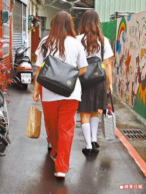 Several high school girls in Taiwan in school uniforms.