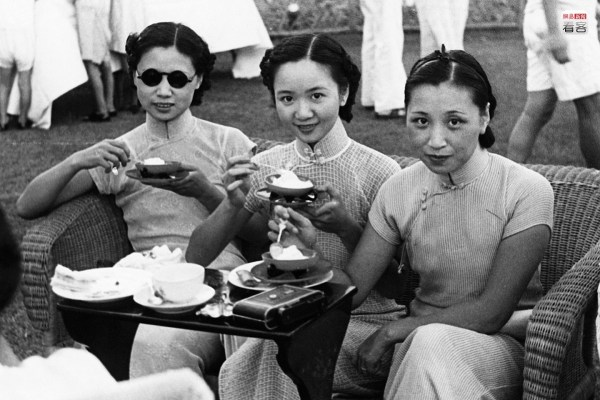 Apart from films, sports competitions and the like had also become a pursuit of high society. They never tired of tennis, horse racing and similar sports. Quite a few foreigners established jockey clubs and such organizations here [in Shanghai]. Photo is of three sisters awaiting the start of a tennis match. Corbis.