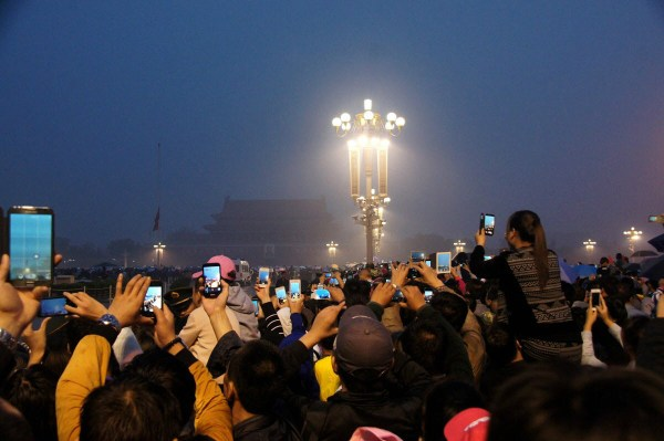 Chinese crowds in Beijing's Tiananmen Square to watch the morning flag raising ceremony on National Day holiday.