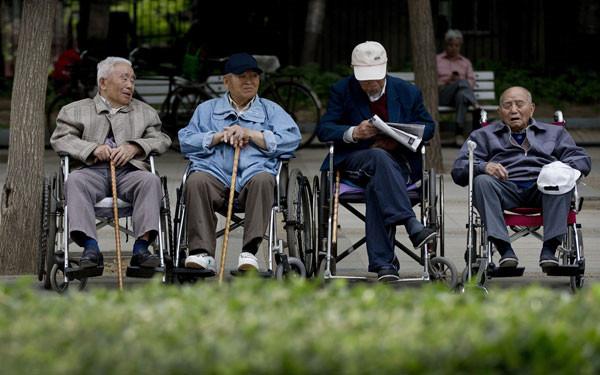 Chinese elderly men in wheelchairs.
