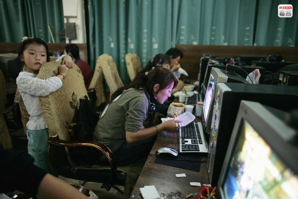 Chinese using computers at an internet bar in China.