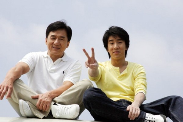 Jackie Chan and son, Jaycee Chan [Fang Zuming], peace/victory sign.