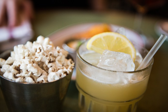El Paso Sours and toasted popcorn with Old Bay Spice Seasoning