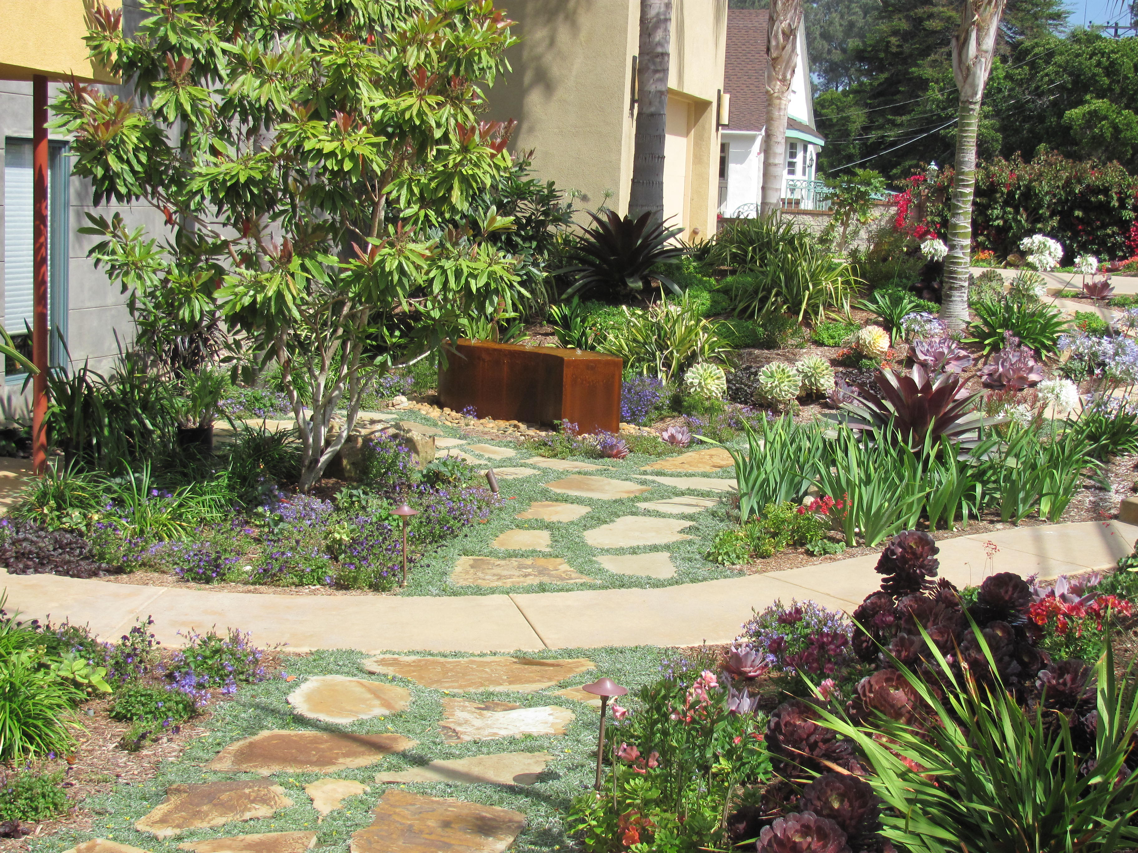 a flagstone path bisects the front garden