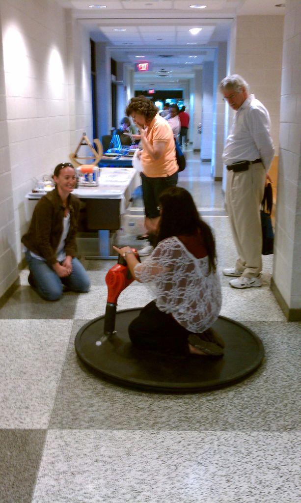 NORFOLK, Va. — Teacher riding the VA Tech hovercraft demonstrator during the CHROME Sponsor Launch- Teacher Training Event on Oct. 18, 2014 at Norfolk State University's Robinson Technology Center.