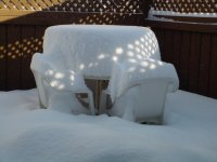 Even deeper snow on the patio table