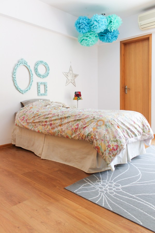 girls room with blue pompoms & frames-11