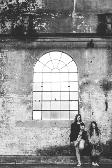 sydney photographers - sisters in front of old building