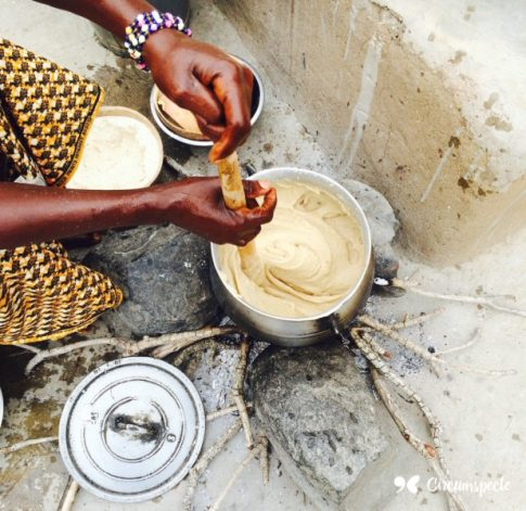A woman prepares tuo zaafi, a maize or millet based starch meal indigenous to Ghana's north
