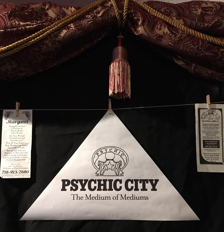 Exhibit logo for Psychic City: The Medium of Mediums with crystal ball