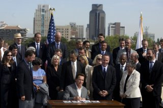 Governor Arnold Schwarzenegger signs SB 375 into law