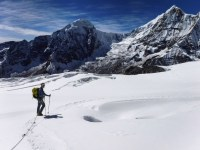 Winding our way past some crevasses on the glacier on Tharpu Chuli