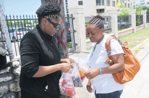 Olivia McKoy selling bag juice in New Kingston