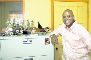 Donovan Germain displays the various awards Penthouse Records has won over the years.