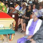 Luciano & his mother at the funeral service for Menelik McClymont