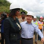 Chinese ambassador to Jamaica Dong Xiaojun shows Portia Simpson around the North/South Highway construction