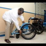 CEO Errol Greene examines a scrapped wheel chair