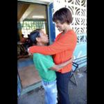 Former Prime Minister Portia Simpson Miller gets a hug from a fan