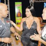 Mark Telfer, brand manager, Magnum Tonic Wine (left) holds court with the show's host Yanique 'Curvy Diva' Barrett (centre) and producer Natalie Parboosingh. (Photo: Joseph Wellington)