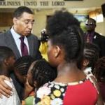 Children being comforted by Prime Minister Andrew Holness