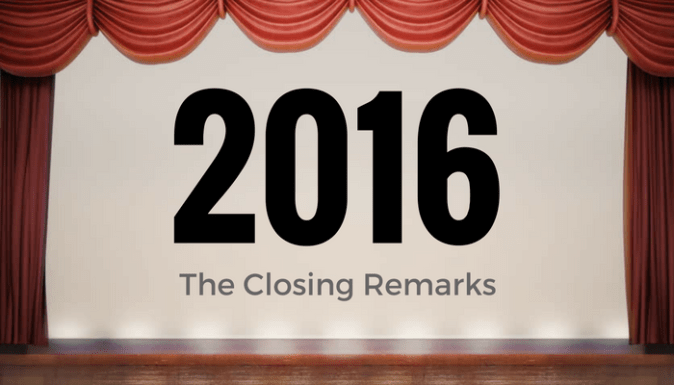 A stage with orange curtains and the closing remarks of 2016