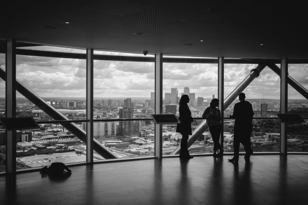 Black and white photo of a meeting in a skyscraper