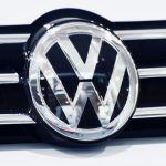 The emblem of Volkswagen is displayed with its vehicle at a show room in Tokyo on July 28, 2016. Toyota is in danger of losing its crown as the world's biggest automaker this year as sales fall behind those of German rival Volkswagen, new figures showed on July 28, 2016. / AFP / KAZUHIRO NOGI        (Photo credit should read KAZUHIRO NOGI/AFP/Getty Images)
