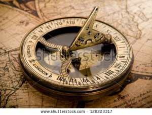 stock-photo-old-compass-on-vintage-map-128223317