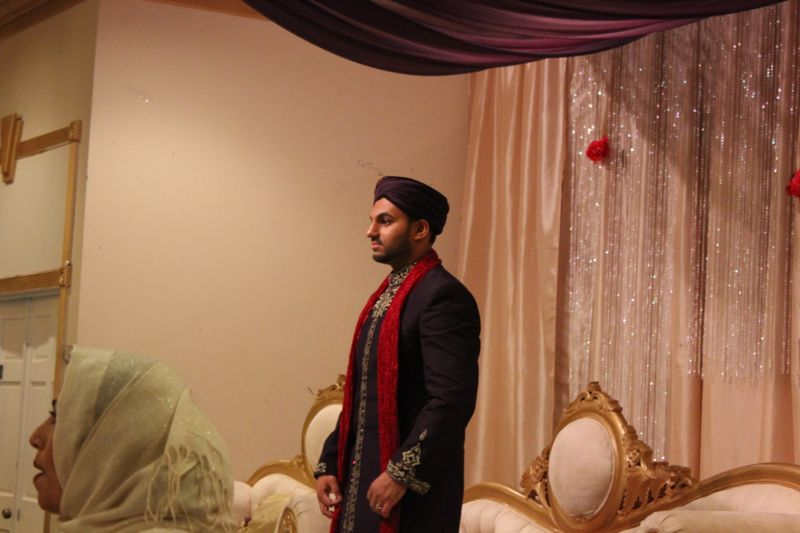 My cousin waiting for the arrival of his bride.
