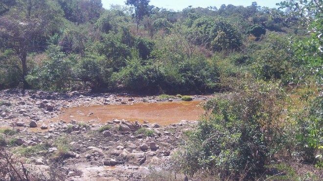 The San Sebastian River, the main water source for the community of San Sebastian, left contaminated by a defunct mining operation. The U.S.-based company responsible for the contamination, Commerce Group, is now suing the Salvadoran government for permission to renew mining activities. Photo source: Danielle Marie Mackey