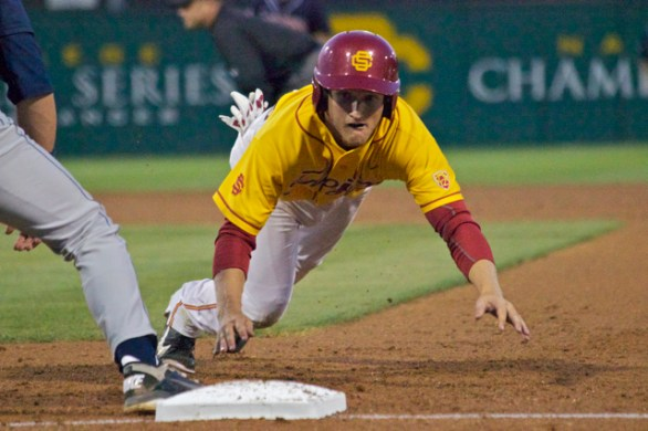 Blake Lacey dives back to first. (Photo: Shotgun Spratling)