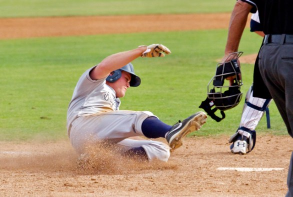 Brennon Lund slides in safely with the game's only run. (Photo: Shotgun Spratling)