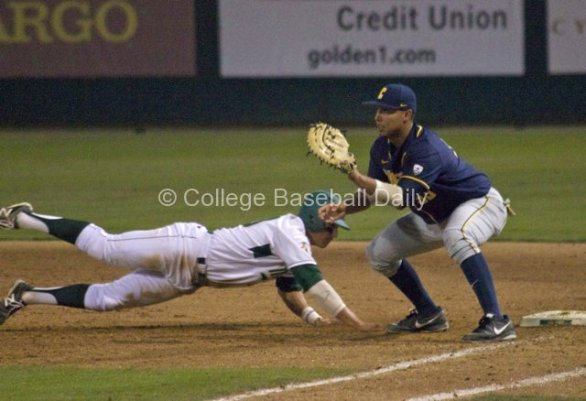 Nick Torres dives back to first.