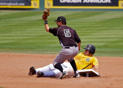 Peter Van Gansen shows the ball while Prigatano pulls up the base. (Photo: Shotgun Spratling)
