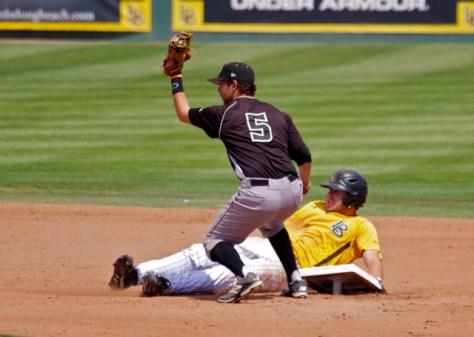 Peter Van Gansen shows the ball while Prigatano pulls up the base. (Photo: Shotgun Spratling)