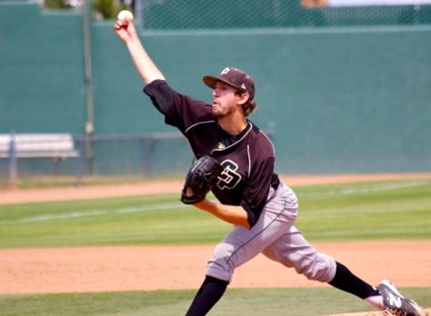 Casey Bloomquist injured his left knee on this pitch. (Photo: Shotgun Spratling)