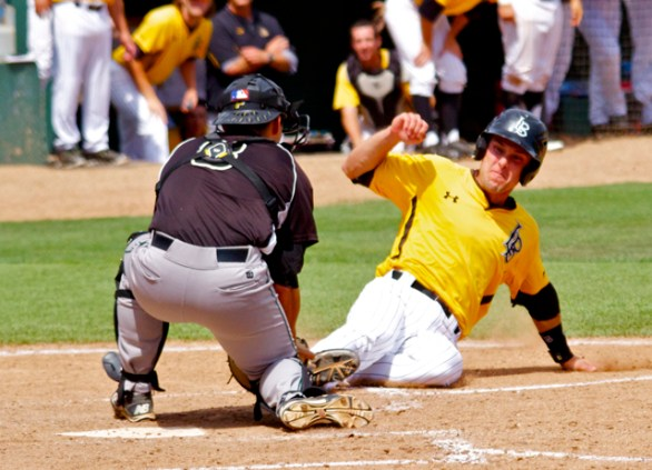 Chris Hoo blocks the plate and tags Colton Vaughn. (Photo: Shotgun Spratling)