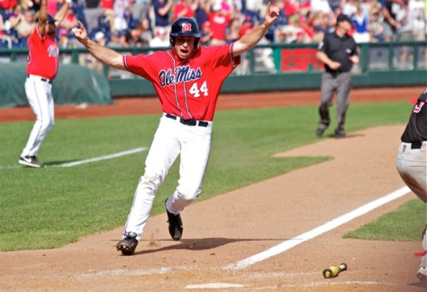 Aaron Greenwood celebrates as he scores the winning run. (Photo: Shotgun Spratling)