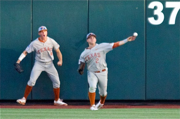 Collin Shaw is pumped up at Mark Payton's diving catch. (Photo: Shotgun Spratling)