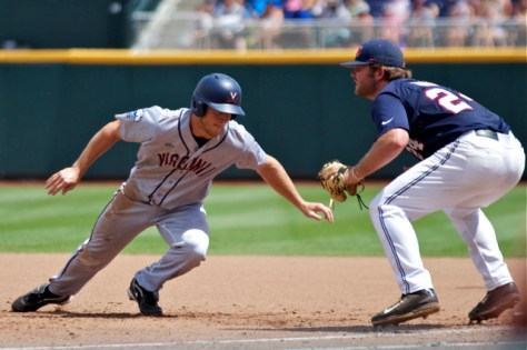 Joe McCarthy dives back into first base. (Photo: Shotgun Spratling)