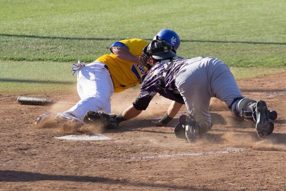Cody Hough is thrown out the plate in the ninth inning. (Photo: Mark Alexander)