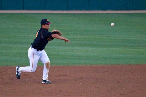 Frankie Rios throws to first. (Photo: Shotgun Spratling)