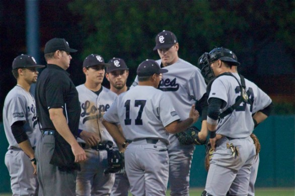 The umpire tries to break up Grand Canyon's huddle on the mound. (Photo: Shotgun Spratling)