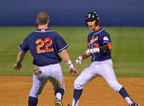 Austin Diemer chases down Jared Deacon to celebrate the walk-off squeeze bunt. (Photo: Shotgun Spratling)