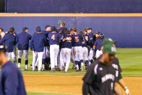 The Titans celebrate the sweep while Hawai'i walks away disappointed. (Photo: Shotgun Spratling)