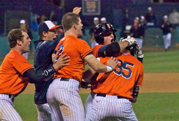 Tanner Pinkston is bombarded by his teammates. (Photo: Shotgun Spratling)