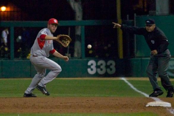Casey Grayson fields a one-hopper down the line.